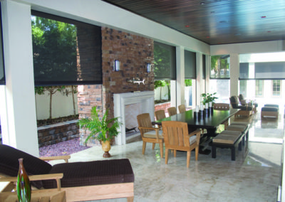 Outdoor motorised blinds in the alfresco dining area